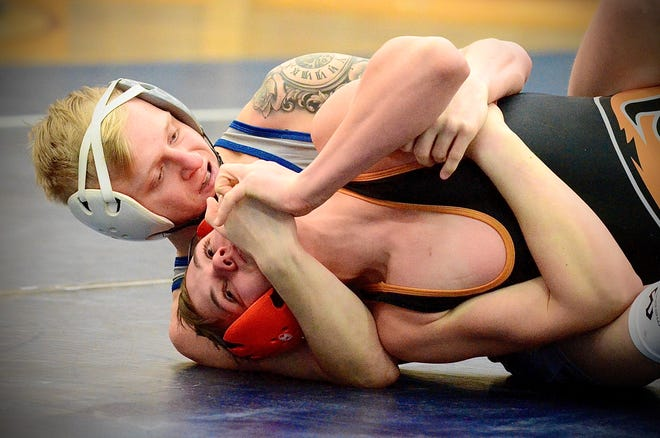 Richmond's Josh Barton gets ready to pin Almont's Connor Durall during the Division 3 wrestling districts on Wednesday, Feb. 12, 2020, at Richmond.
