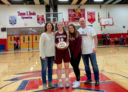 Arlington's Molly Stephens poses with her family after eclipsing 1,000 career points on Feb. 12. From left: Denise Stephens, Molly Stephens, Emma Stephens, Scott Stephens.