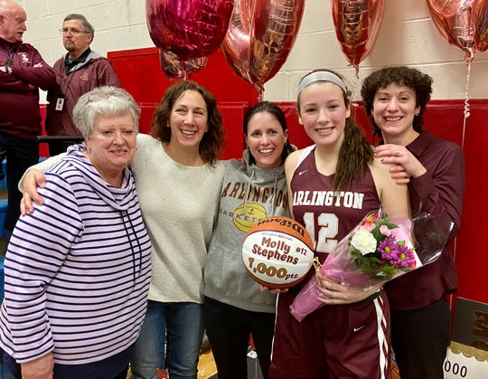 Arlington girls basketball star Molly Stephens poses in celebration of her 1,000th career point on Wednesday. From left: Gloria Costello, Denise Stephens, Jenna Siegrist-Costello, Molly Stephens and coach Kim Costello.
