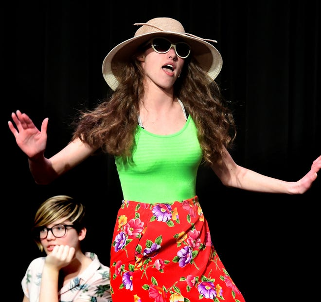 """Northeastern High School senior Hannah Wildasin sings in her role as Tanya during a rehearsal for """"Mamma Mia!"""" at the school Wednesday, Feb. 12, 2020. The show runs February 20, 21, and 22 at 7:00 pm & February 23 at 2:00 p.m. Bill Kalina photo"""