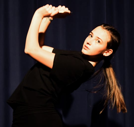 "Northeastern High School sophomore Mackenzie Miller performs a dance during a rehearsal for ""Mamma Mia!"" at the school Wednesday, Feb. 12, 2020. The show runs February 20, 21, and 22 at 7:00 pm & February 23 at 2:00 p.m. Bill Kalina photo"