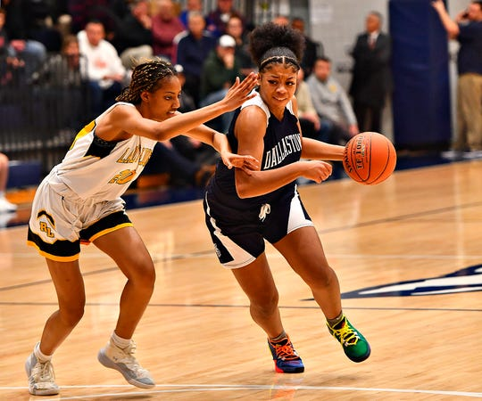 Dallastown's Bria Beverly, right, works to get around Red Lion's Makiah Shaw during girls' basketball semifinal action at Dallastown Area High School in York Township, Wednesday, Feb. 12, 2020. Dawn J. Sagert photo