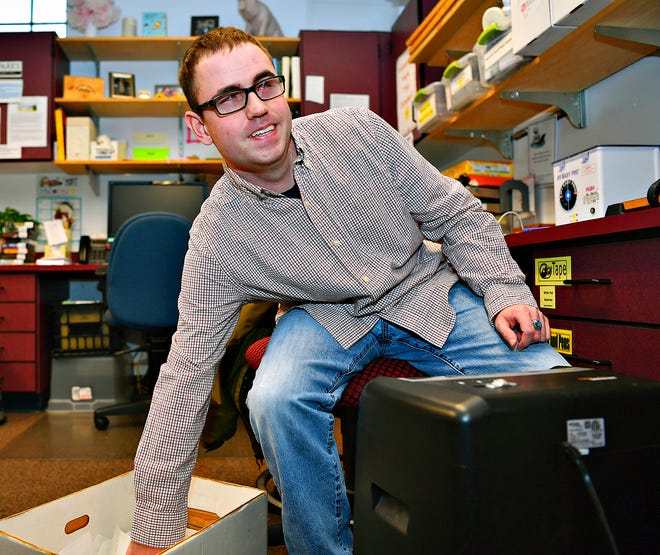 Preston Gaylor, 25, of Stewartstown, shreds papers for The Paul Smith Library of Southern York County in Shrewsbury Borough, Thursday, Feb. 13, 2020. Gaylor volunteers at the library bi-weekly. Dawn J. Sagert photo