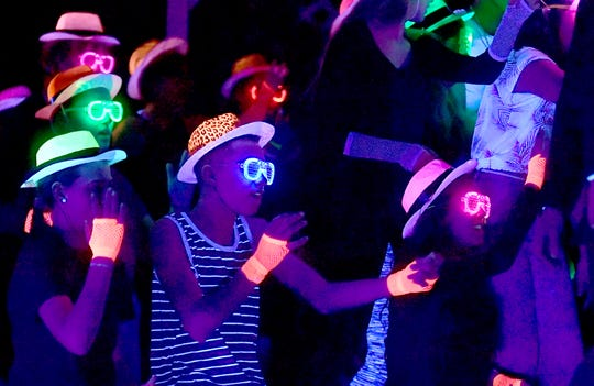 "Northeastern High School students perform a scene under black light during a rehearsal for ""Mamma Mia!"" at the school Wednesday, Feb. 12, 2020. The show runs February 20, 21, and 22 at 7:00 pm & February 23 at 2:00 p.m. Bill Kalina photo"
