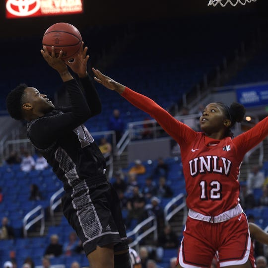 Nevada's Marguerite Effa shoots while taking on UNLV during their basketball game at Lawlor Events Center in Reno on Feb. 12, 2020.