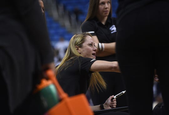 Nevada head coach Amanda Levens talk with her players during a timeout while taking on UNLV during their basketball game at Lawlor Events Center in Reno on Feb. 12, 2020.
