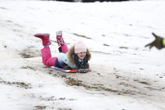Brandi Zizert sleds down Roosevelt Hill on Thursday, Feb. 13, 2020, at Glen Miller Park.