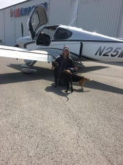 Darrin Nelson overcame his fear of heights and planes to become a pilot and help fly rescue dogs.