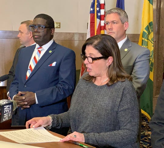 "Monroe County Legislator Karla Boyce, a Republican, is flanked by Democratic Minority Leader Vince Felder, left, and County Executive Adam Bello, as she announces her support to repeal the county's police ""anti-annoyance"" law Thursday."
