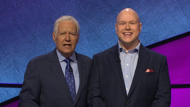 """Rochester's Josh Gruenberg, pictured with Alex Trebek, will defend his """"Jeopardy!"""" crown on Thursday night's broadcast."""