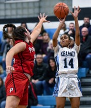 Bishop Kearney's Camille Wright, right, takes a shot over Penfield's Jessica Rinere during a regular season game at Bishop Kearney High School, Wednesday, Feb. 12, 2020. Bishop Kearney beat Penfield 56-44.