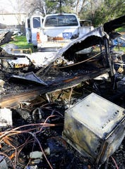 A cab-over camper and a Silver Streak camp trailer owned by Gary Mantei burned Wednesday night off Henderson Road in Redding. A neighbor helped save both Mantei and Bud the chihuahua after the blaze broke out.