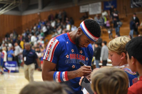 Kids lined up after the game to get autographs from the Harlem Globetrotter players. Feb. 12, 2020.