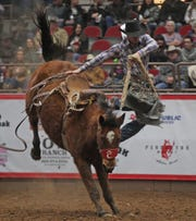 Tanner Butner competes in the saddle bronc event at the San Angelo Stock Show and Rodeo on Wednesday, Feb. 12, 2020.