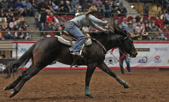 Katelyn Scott competes in the barrel racing event at the San Angelo Stock Show and Rodeo on Wednesday, Feb. 12, 2020.
