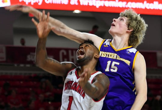 Ty Chisom of USD yells as the arm of Western Illinois' Ben Pyle comes down on his head on Wednesday, Feb. 12, at the Sanford Coyote Sports Center in Vermillion.