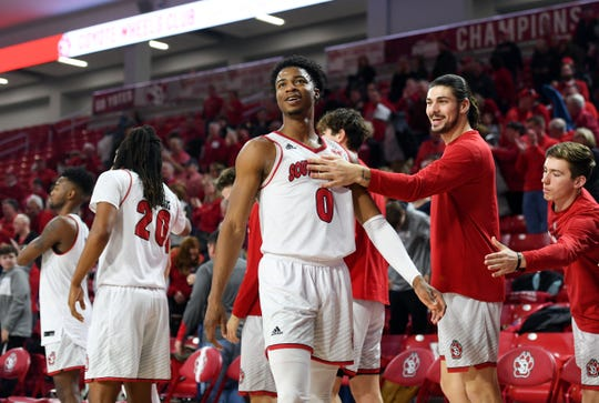 Stanley Umude of USD smiles as he walks back to his teammates after beating Western Illinois on Wednesday, Feb. 12, at the Sanford Coyote Sports Center in Vermillion.