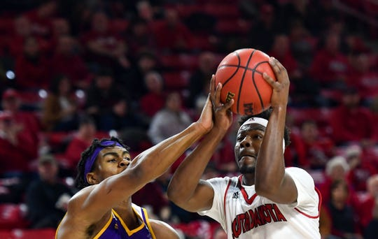 Triston Simpson of USD reaches the ball toward the basket while Zion Young of Western Illinois attempts to block on Wednesday, Feb. 12, at the Sanford Coyote Sports Center in Vermillion.
