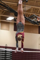 Harrisburg senior Kenzee Danielson competes on bars at the ESD Conference Meet on Feb. 8, 2020.