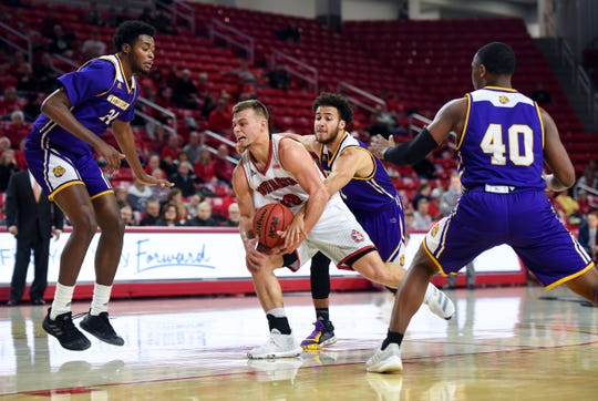 Cody Kelley of USD pushes past Western Illinois defense during their game on Wednesday, Feb. 12, at the Sanford Coyote Sports Center in Vermillion.