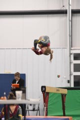 Harrisburg senior Kenzee Danielson competes on beam at the ESD Conference Meet on Feb. 8, 2020.