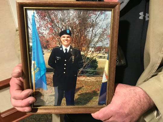 Jeff Dahl holds a photo of his son Jacob Dahl of Castlewood. Jacob was a 19-year-old Northern State University student when he was killed after running into a soybean truck while looking at his cell phone.