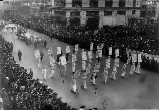League of Women Voters marching