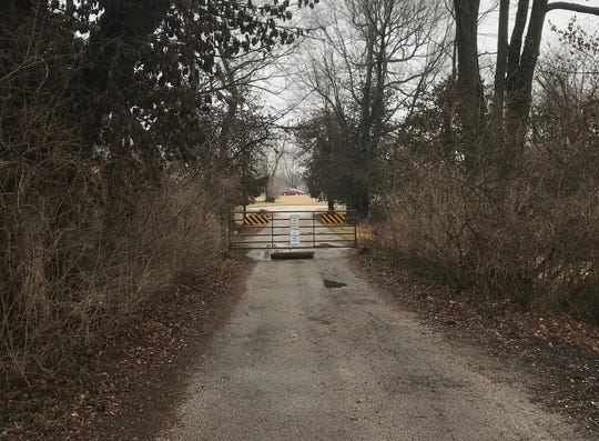 Who owns Fritts Lane? Homeowners who this month put up a gate to block traffic apparently think they do.