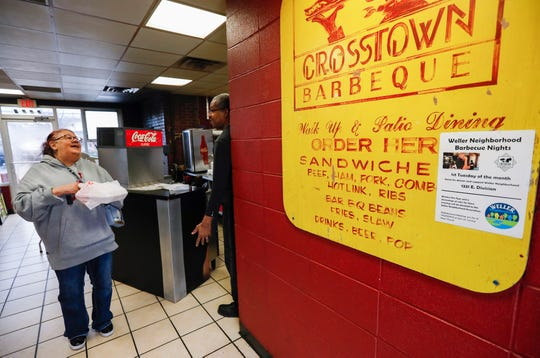 Steve Williams, right, owner of Crosstown Barbecue, talks with longtime customer Nelida Mercado on Tuesday, Feb. 4, 2020.