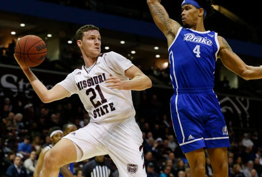 Ross Owens, of Missouri State University, passes the ball across the baseline during the Bears' game against Drake on Wednesday, Feb. 12, 2020.