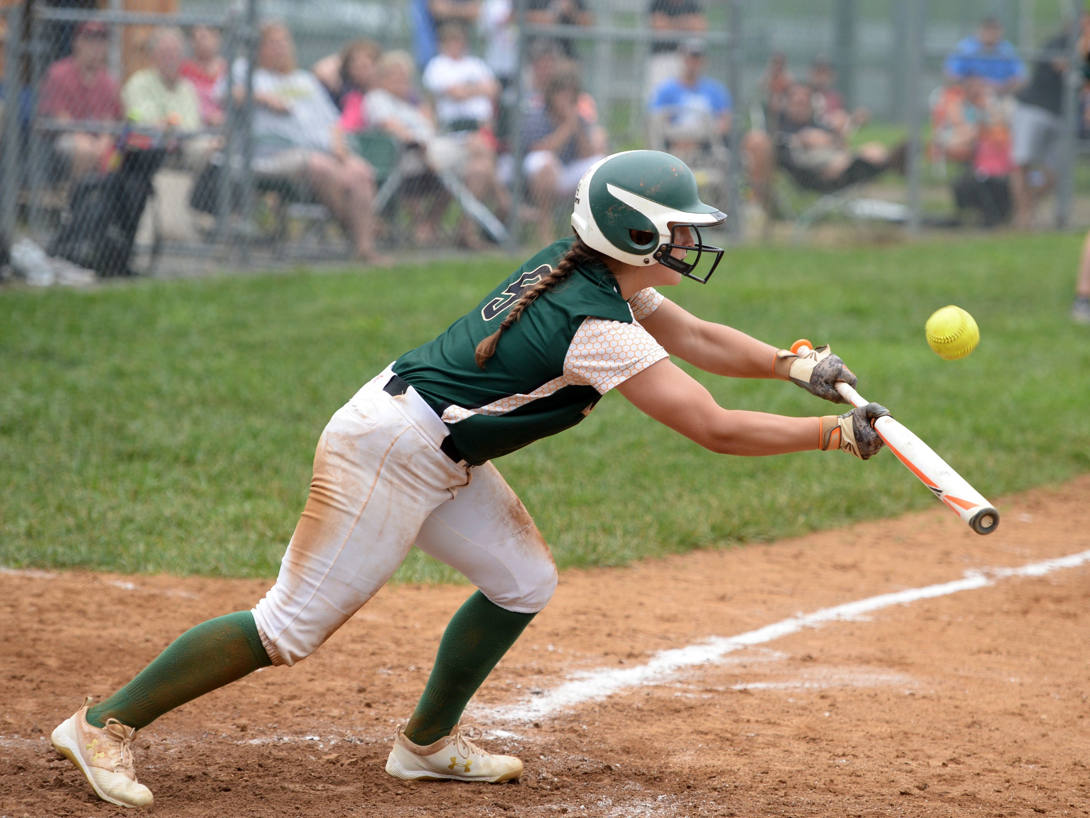A Wilson Memorial softball player bunts. Players and parents across the county have requested that the Board of Supervisors funds lights for all five softball fields.