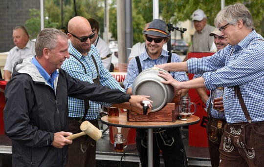 St. Cloud Mayor Dave Kleis participates in the ceremonial tapping of the first keg Sept. 24, 2016, at the Oktoberfest celebration at Beaver Island Brewing Co.