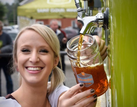 Sarah Gaitlin pours a fresh mug of Oktoberfest beer during the 2016 Oktoberfest event at Beaver Island Brewing Co. in St. Cloud.