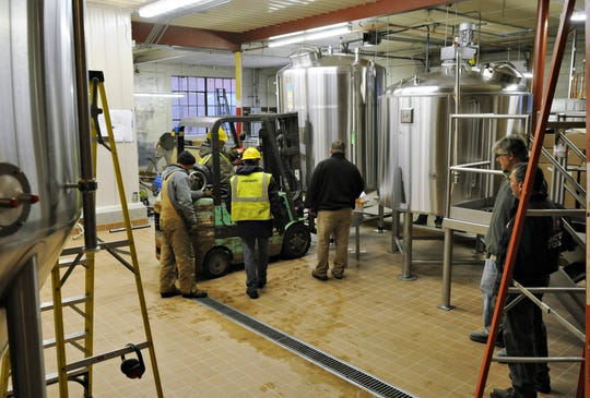 The last new brewing tank is moved into place in the production area at the Beaver Island Brewing Co. in Dec., 2014.