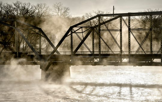 Steam fog rises from open water on the Mississippi River near the old Sartell bridge as temperatures hover around minus-18 on Thursday morning.