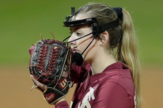 Florida State University's Caylan Arnold (12) prepares to pitch during a game between Florida State and Florida A&M University at JoAnne Graf Field Wednesday, Feb. 12, 2020.