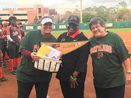 Florida State current softball head coach Lonni Alameda (left) and Seminoles coaching legend JoAnne Graf presented FAMU softball coach Veronica Wiggins with a gift basket before the game on Wednesday, Feb. 12, 2020. Wiggins is retiring at the end of the season. This trio has combined for 2,909 wins.