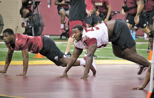 Cornerback A.J. Lytton and defensive tackle Malcolm Ray at a Tour of Duty conditioning workout on Feb. 13, 2020.