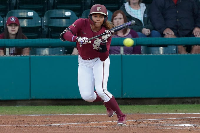 FSU's Elizabeth Mason (5) bunts during a game between Florida State and Florida A&M University on Wednesday, Feb. 12, 2020.