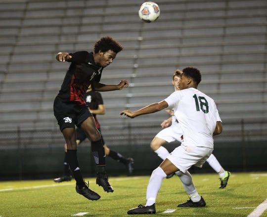 Leon junior defender Khari Davis heads a ball forward as Leon's boys soccer team beat Lincoln 4-2 during a Region 1-6A quarterfinal playoff game on Feb. 12, 2020.