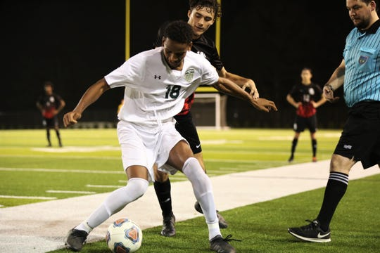 Leon's Jackson Rabon and Lincoln's David Monroe fight for possession on a restart as Leon's boys soccer team beat Lincoln 4-2 during a Region 1-6A quarterfinal playoff game on Feb. 12, 2020.