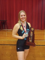 Jensen Beach senior weightlifter Morgan Wiswell shows off her regional championship medal.
