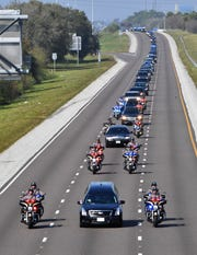 The funeral procession for FHP Trooper Joseph Bullock precedes south on I-75 Thursday, Feb. 13, 2020, through Sarasota, traveling to the Sarasota National Cemetery. Trooper Bullock was shot and killed last week when he stopped to help a motorist in Martin County.