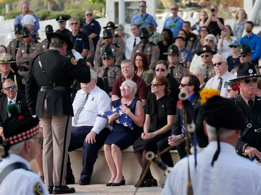The American flag, taken from the casket of slain Florida Highway Patrol Trooper Joseph Bullock, was presented to his family Thursday Feb. 13, 2020, at Sarasota National Cemetery. Trooper Bullock was killed last week while responding to a stranded motorist in Martin County.