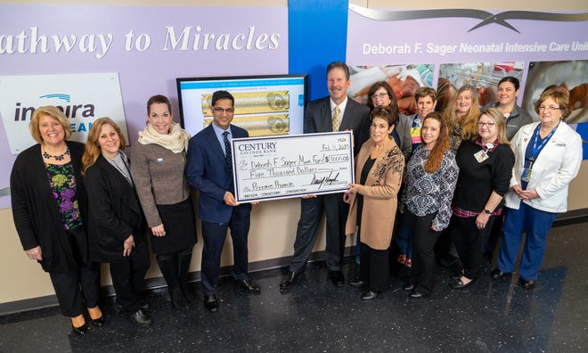 Century Savings Bank recently donated $5,000 to the Deborah F. Sager Memorial Fund in support of the expert care provided by the doctors and nurses of the Deborah F. Sager Neonatal Intensive Care Unit at Inspira Medical Center Vineland. (From left) Dawn Goffredo, administrative director of Maternal Child Health, Inspira Health; Laurie Trongone, assistant vice president of Women's and Children's Services, Inspira Health; Jessica Kowal, chief development officer, Inspira Health; Ashish Gupta MD, neonatologist; David J. Hemple, president and chief executive officer, Century Savings Bank; and Penny Sager-Rossi, founder of the Deborah F. Sager Memorial Fund, were joined by members of the Maternal Child Health team for the check presentation.