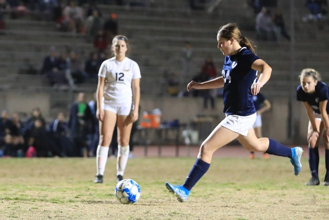 Redwood's Ashley Wainwright attempts to score on a penalty kick against Arroyo Grande in a Central Section Division I high school girls playoff soccer match at Mineral King Bowl on Wednesday, Feb 12th, 2020