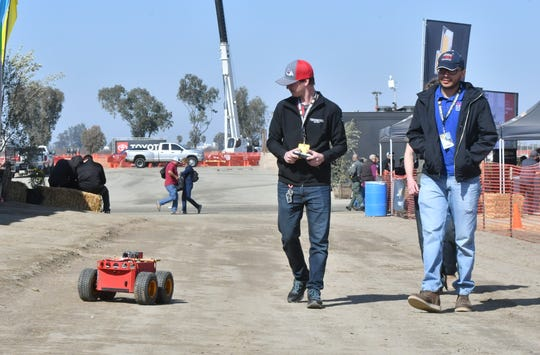 Kory Gilman of Tulare pilots a robot equipped with sensors and cameras that could help Central Valley farmers reduce fertilizer and pesticide usage, protecting the environment while saving growers money.