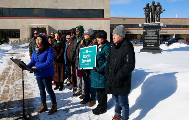 Marathon County board member and Wausau school board candidate Ka Lo addresses the media on Thursday, February 13, 2020, at the Hmong-Lao Veterans Memorial in Wausau, Wis. Lo, along with Wisconsin 7th District congressional candidate Tricia Zunker and Wausau mayoral candidate Katie Rosenberg, responded to President Donald Trump's reported plan to deport non-U.S. citizens to Laos. 