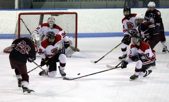Rye (in red and white) shown during a Feb. 12, 2020 loss to Division 1 third-seed Scarsdale, is the second seed in D2 with a 12-8 record.