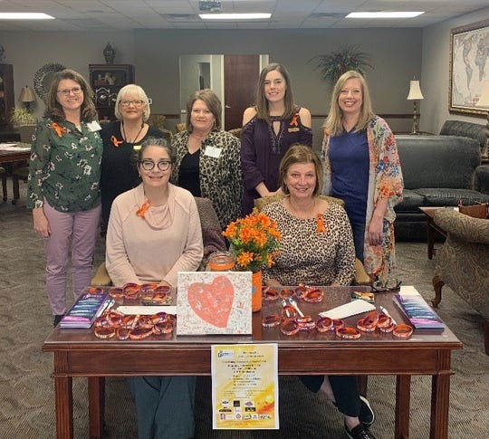 Senior Junior Forum members recently helped with registration at First Step Teen Dating Violence Awareness Event. Bottom Row: left to right, Heidi Hakimi-Hood, Vicki Tigert. Top Row, left to right, Sarah Wood, Connie Joyce, Pam Reese, Lucy Zamastil, Christi Kelton.